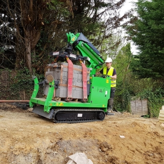 2 - The Hooka tracked forklift mini crane lifts 1 tonne of blocks through site with restricted acces