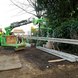3 - The Hooka tracked forklift crane lifts heavy concrete beams ready to carry through site with res