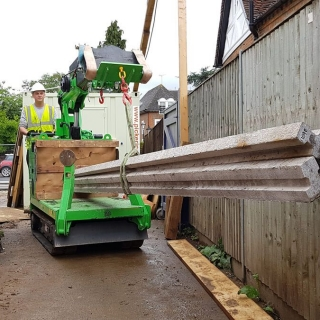 6 - The Hooka lift and carry tracked forklift crane transports heavy concrete beams on to site with