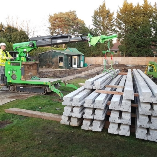 7 - The Hooka lift and carry tracked forklift crane easily and safe stacks heavy concrete beams on s