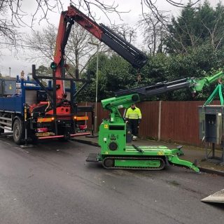 how to safely move utility power distribution equipment with Hooka pick and carry mini spider crane