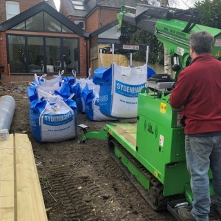 10 Safely moving 1 tonne bags landscaping materials Winchester Hampshire with Hooka lift and carry tracked forklift
