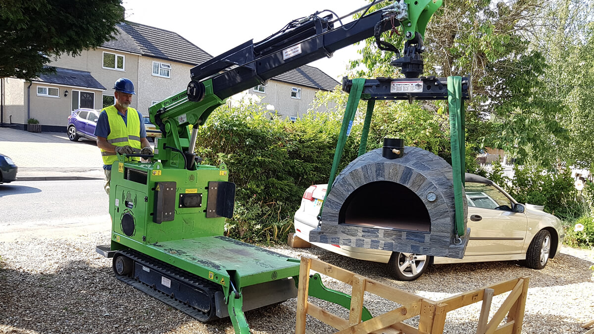 Moving heavy pizza oven safely with the Hooka lift and carry crawler crane