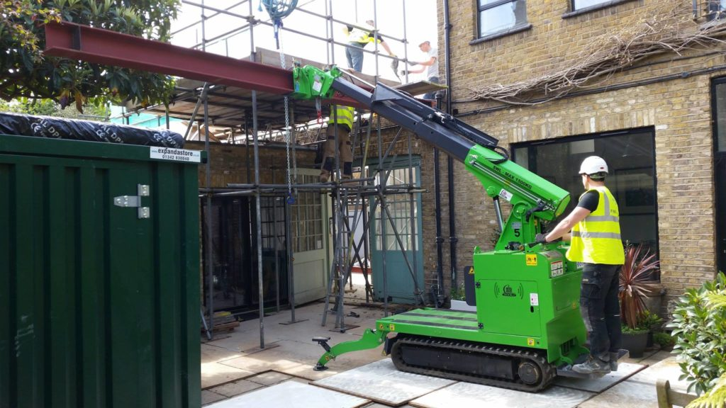 The Hooka mini tracked crawler crane with steel beam manipulator head installing Steel Beams in London. The ultimate steel I-beam lifter.