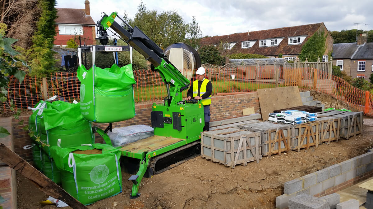 The Hooka pick and carry crane easily lifting and carrying bulk bag on restricted access site