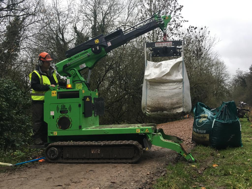 The Hooka mini tracked crawler crane, alternative to mini tracked dumper, on hire delivering bulk bags to point of use without need for manual handling