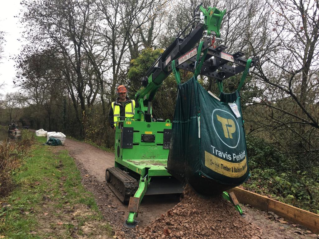 The Hooka mini tracked crawler crane, alternative to mini tracked dumper, on hire emptying bulk bags on restricted towpath better alterntative to a tracked dumper and digger