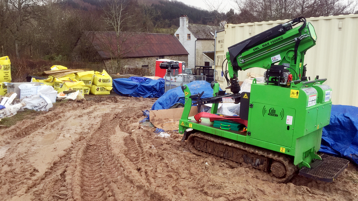 The Hooka, mini tracked crawler crane, on site hire with DIY SOS the only machine that could cope with such muddy conditions to move bulk bags