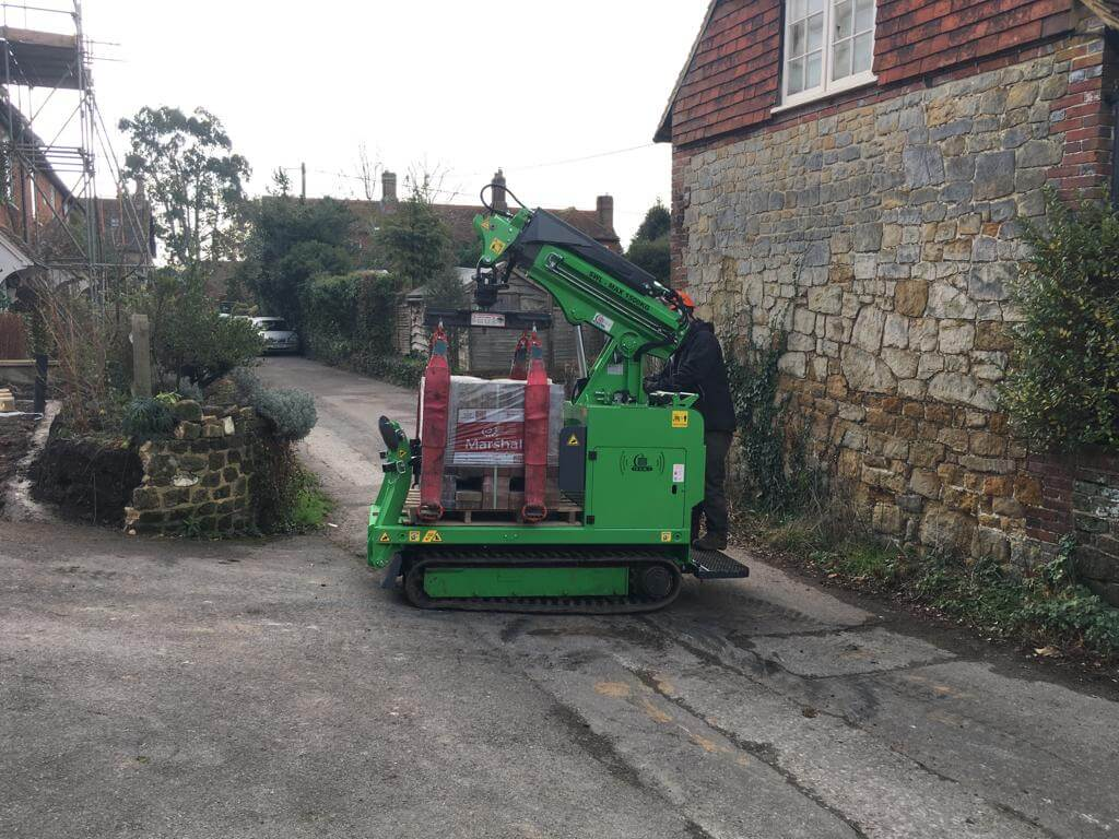 Hooka all terrain tracked dumper better alternative mini crane on hire in West Sussex to safely lift and move heavy pallet of Marshalls block paving