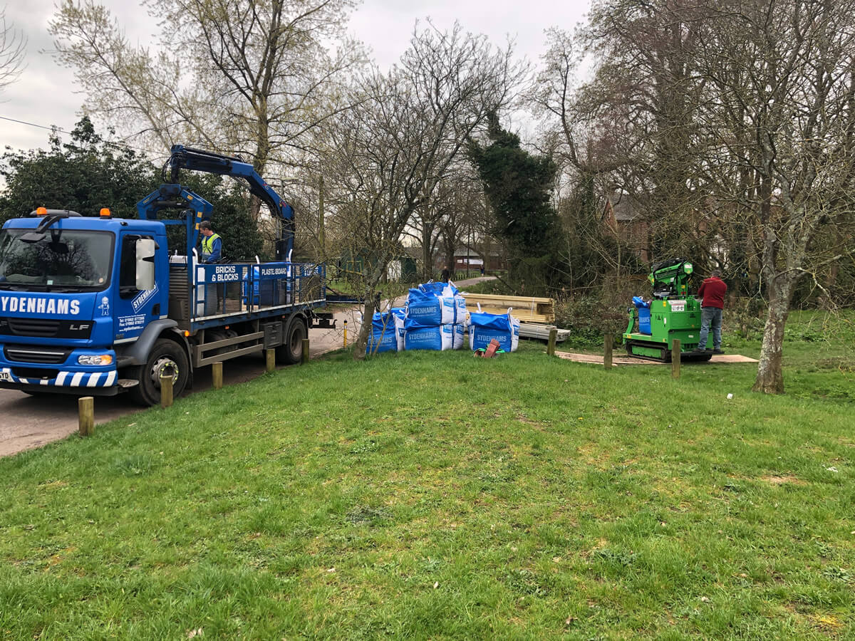 Safely moving 1 tonne bags of landscape materials in Winchester Hampshire with Hooka lift and carry tracked mini-crane