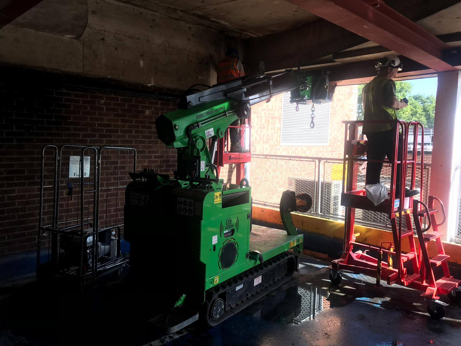 Hooka installing steel beams in Gloucester, lift and carry crawler crane tracked forklift